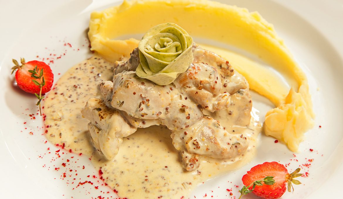 Rabbit in a creamy mustard sauce with mashed potatoes