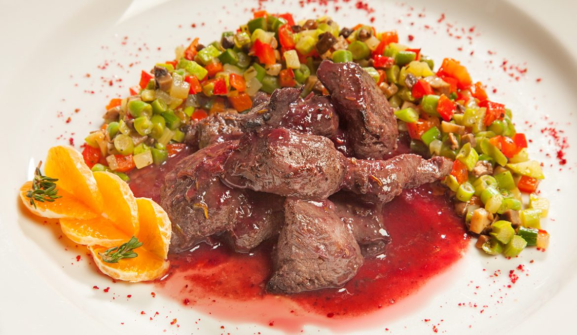 Venison stewed in sauce with sauteed vegetables